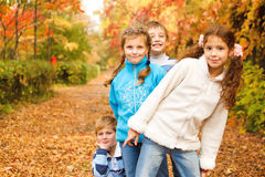 Kids in park. Kids group in autumn park royalty free stock image