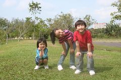 Kids at the park. Happy girls and boy at the park in the afternoon Stock Photos