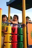 Kids at the park. Two girls and one boy playing at the park Royalty Free Stock Photography