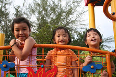 Kids at the park. Two giris and a boy playing at the park Stock Image