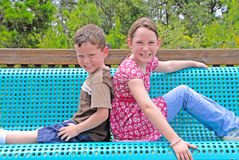 Kids on park bench Stock Photo