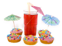 Kids party. Glass with straws and birthday cakes isolated Stock Photos