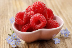 Kids party: bowl of fresh raspberries Stock Photography