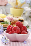 Kids party: bowl of fresh raspberries Stock Photos