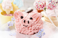Kids party: cute pink piglet cake. Festive and party dessert royalty free stock image