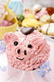 Kids party: cute pink piglet cake Royalty Free Stock Photos