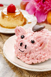 Kids party: cute pink piglet cake. And stunning peonies in the background. Spring set Royalty Free Stock Photos
