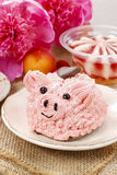 Kids party: cute pink piglet cake. And stunning peonies in the background. Spring set Royalty Free Stock Images