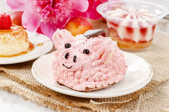 Kids party: cute pink piglet cake. And stunning peonies in the background. Spring set Stock Image