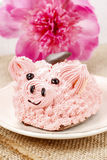 Kids party: cute pink piglet cake. And stunning peonies in the background. Spring set Royalty Free Stock Photography