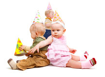 Kids in party hats Stock Photography