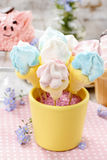 Kids party: marshmallow cake pops in yellow bucket Stock Images