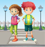 Kids at the pedestrian lane Royalty Free Stock Photos