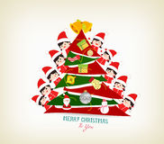 Kids peeping behind christmas tree. Merry christmas background and greeting card design Stock Images