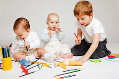 Kids and pencils stock photo