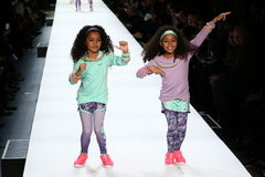Kids perform on the runway during Rookie USA Presents Kids Rock! Fall 2016. NEW YORK, NY - FEBRUARY 11: Kids perform on the runway during Rookie USA Presents Royalty Free Stock Photography