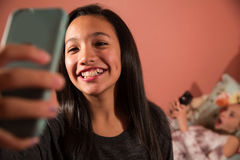 Kids with phone Stock Photo