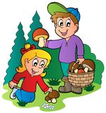 Kids picking up mushrooms Stock Photography