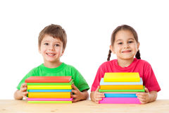 Kids with pile of books Stock Photos