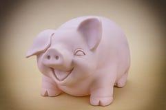 Kids Pink Piggy Bank. Looking Forward Royalty Free Stock Image