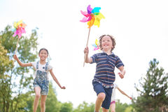 Kids with pinwheels Stock Image