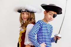 Kids in a pirate costume. A portrait of two kids in a pirate costume stock photography