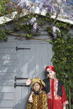 Kids In Pirate And Jaguar Costumes Against Shed Stock Photography