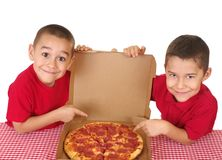 Kids and pizza. Boys six and seven years old ready to eat a take-out pepperoni pizza, on white background Stock Images