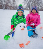 Kids plaing in the snow Stock Photos