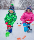 Kids plaing in the snow Royalty Free Stock Photo