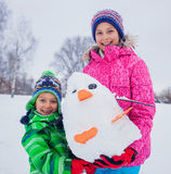 Kids plaing in the snow Royalty Free Stock Image