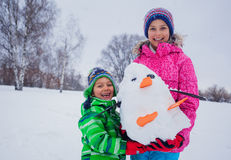 Kids plaing in the snow Royalty Free Stock Photography