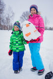 Kids plaing in the snow Stock Photography