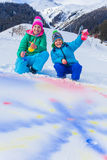 Kids plaing in the snow Royalty Free Stock Photos