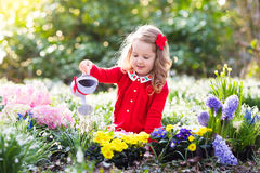 Free Kids Plant And Water Flowers In Spring Garden Stock Photography - 85932042