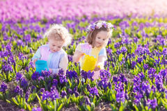 Free Kids Plant And Water Flowers In Spring Garden Royalty Free Stock Photos - 87889688