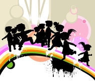 Kids at play. Kids silhouettes running and jumping Royalty Free Stock Photography
