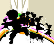Kids at play. Kids silhouettes running and jumping Royalty Free Stock Photos
