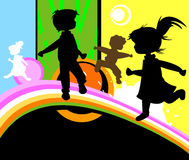 Kids at play. Kids silhouettes running and jumping Stock Photography