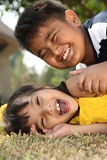 Kids at Play. Two Asian kids playing in the park Royalty Free Stock Image