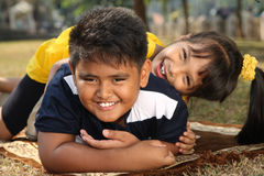 Kids at Play. Two Asian kids playing in the park Royalty Free Stock Photography