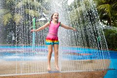 Kids play in aqua park. Children at water playground of tropical amusement park. Little girl at swimming pool. Child playing at. Water slide on summer vacation stock photography