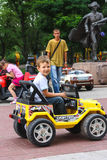 Kids in the play area riding a toy car. Nikolaev, Ukraine Royalty Free Stock Image