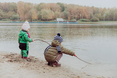Kids play in autumn nature Royalty Free Stock Image