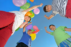 Kids play with balloons Royalty Free Stock Image