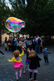 Kids play a bubbles Royalty Free Stock Images