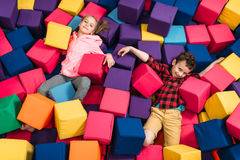 Kids play in child entertainment center. Smiling kids play in child entertainment center. Happy childhood Royalty Free Stock Photo