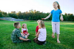 Kids play duck duck goose stock image