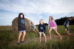 Kids play at field Stock Images