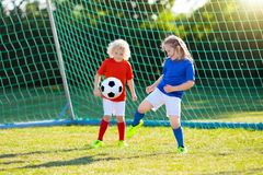 Kids play football. Child at soccer field. Stock Image